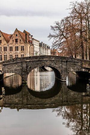 Buildings around channels and bridge in Bruges, Belgium