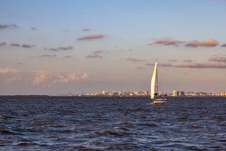 Boat in Guaiba lake with Porto Alegre in background, Rio Grande do Sul, Brazil