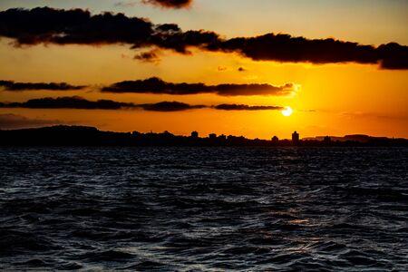 Silhouette of Guaiba city at sunset, Rio Grande do Sul, Brazil