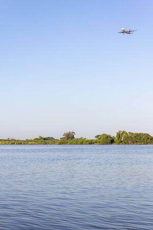 Airplane over Guaiba lake in Porto Alegre, Rio Grande do Sul, Brazil
