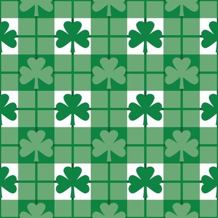 Seamless plaid pattern with green shamrocks. Repeats 12 inches. Vector