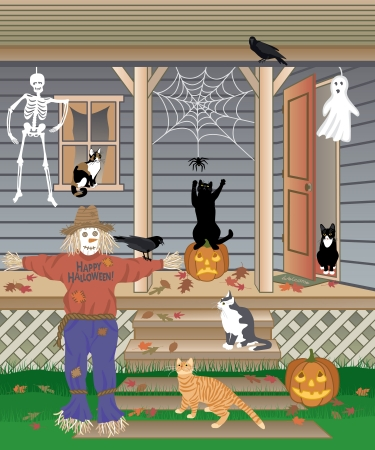 Cats playing with Halloween decorations.