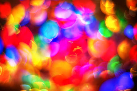 Beautiful colorful abstract background with christmas lights in boken. Amazing holiday texture for design. Wide screen wallpaper with decorative pattern of lights spots.