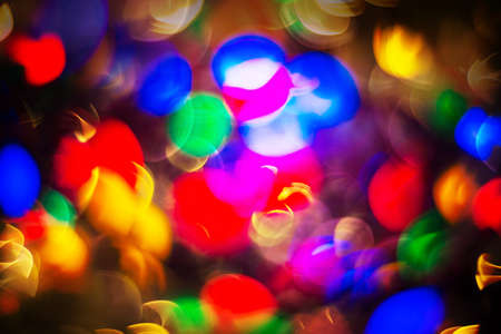 Colorful background with christmas lights in boken. Bright holiday color texture for design. New year background concept.