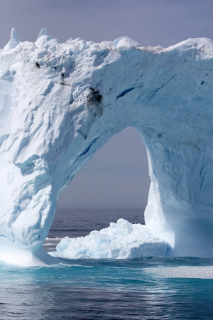 Giant arched iceberg off the coast of Greenland, Atlantic Ocean