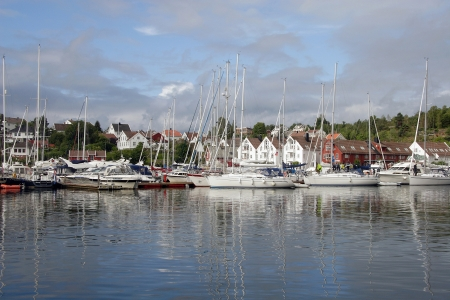 A calm summers day in Marina Kristiansand Lillesand, Norway  Stock Photo