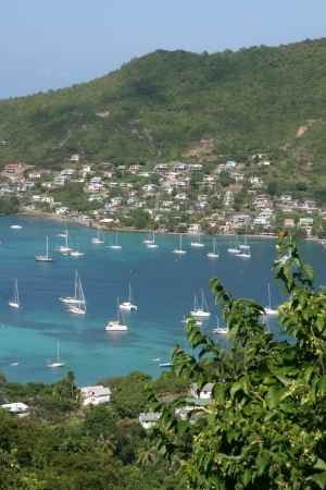 Tropical turquoise waters of Bequia Harbour, Caribbean photo