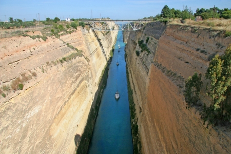 isthmus: View looking down from the top of the canal walls  Small boats can be seen passing through the ancient canal, Corinth, Greece