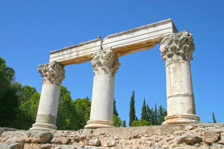 Corinthian order columns against a bright blue sky, Ancient Corinth, Greece photo