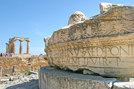 Beautiful carved greek typography in the stone with the temple of Apollo