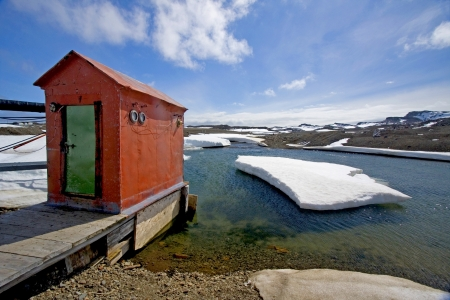 polar station: Hut or Out house on a jetty, near Bellingshausen station, Russian base, Antarctica Stock Photo