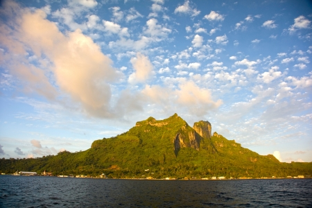 tahiti: Beautiful cloud formations over the peaks of the extinct volcanos of Mount Pahia   Mount Otemanu, Bora Bora, French Polynesia