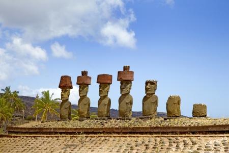scoria: Ahu Nau Nau Moai Statues at Anakena Beach with red scoria headdress