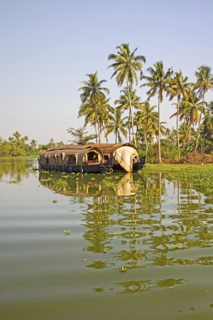 sailling: Traditional house boat sailling along the canal in the backwaters near Alleppey, Kerala, India  Stock Photo