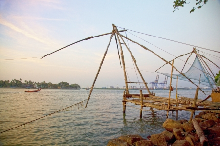 chinese fishing nets: Traditional Chinese fishing nets at sunset, Cochin, India