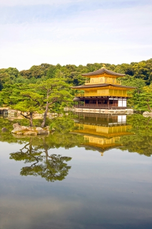 Reflections of the zen buddhist Temple of the Golden Pavillion  kinkaku-ji , Kyoto, Japan