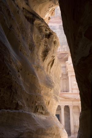 siq: First view of the Treasury  Al Khazneh  through the Siq, Petra, Jordan  Stock Photo