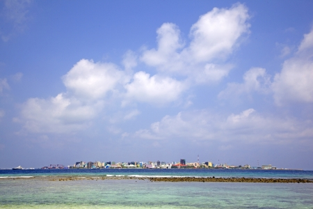 Island   capital city of Male, with colourful buildings, Male, Maldives  photo