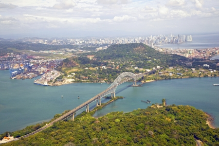canals: Aerial view of the Bridge of the Americas at the Pacific entrance to the Panama Canal with Panama City in the background