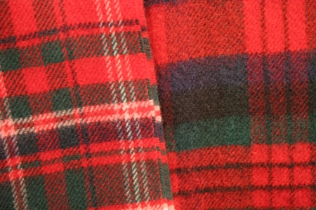 Close up of tartan fabric  Combination of reds, greens, blues   cream  Traditionally Scotish representing clans  Stock Photo