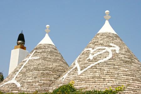 trulli: Painted Conical Truli roofs in the center of Alberobello, Puglia, Italy