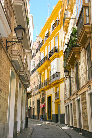 Typical street with traditioal architecture in Cadiz, Andalusia, southern Spain  photo