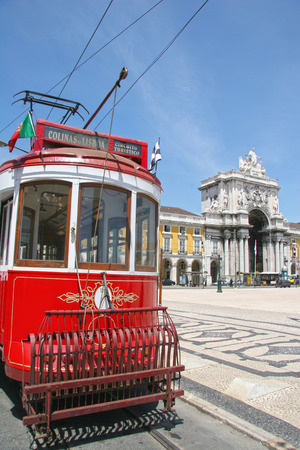 Traditional red tram in Praca do Comercio (or Commerce Square), Lisbon, Portugal.