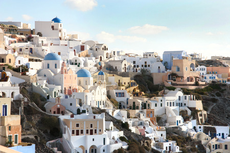 panoramic roof: Oia town with tradional buildings painted white on the cliffside, Santorini, Cyclades, Greece.