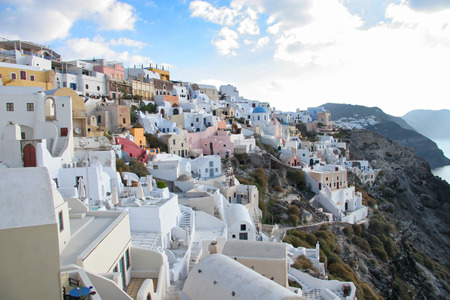 sea of houses: Oia town with tradional buildings painted white on the cliffside, Santorini, Cyclades, Greece.