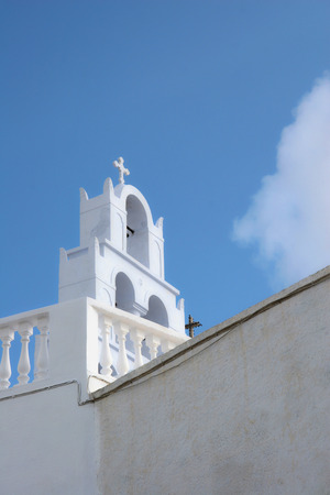 church bells: Bell tower of a traditional whitewashed church, Oia, Santorini, Greece. Stock Photo
