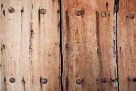 Worn, weathered wooden door or gate with strong & secure metal nails through it, Cartagena, Colombia. 写真素材