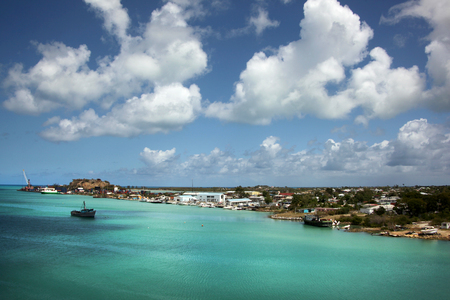 Blue sky & turquoise water. Cruising out of the port of St Johns, Antigua on a beautiful day, Caribbean. Stock Photo