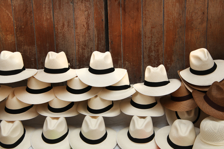 A selection of Panama hats piled up against a wooden door, Cartagena, Colombia. Stockfoto