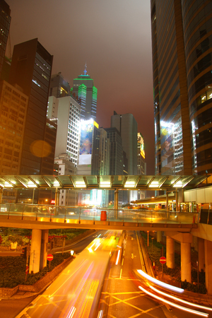 Long Exposure of downtown in the city at twilight, with skyscrappers & traffic, Kong Kong Island, China. Editorial