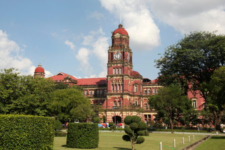 Former colonial red brick High Court Building with its clock tower, Yangon, Myanmar. Editorial