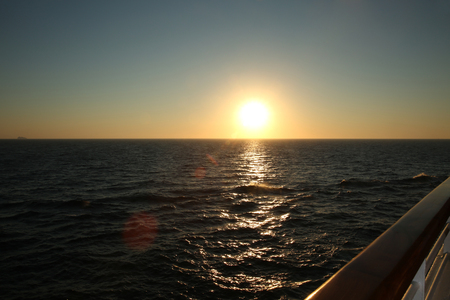 Sunset from the deck of a cruise ship, cruising the Mediteranean Sea. Stock Photo