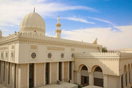 Beautiful Al Sharif Al Hussein bin Ali Mosque, Aqaba, Jordan. Shows the dome roof & carved detailed stone walls.