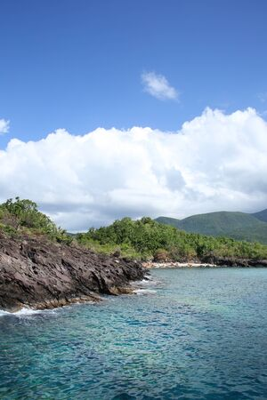 Green mountains on the coastline, Basse Terre, Guadeloupe, French Caribbean.