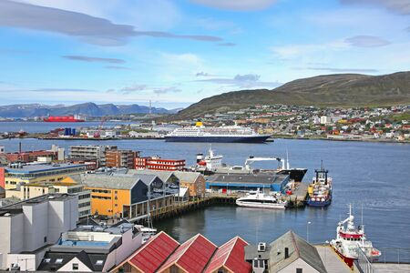 Town of Hammerfest with the downtown area, port, cruise ships & mountains in the background. Hammerfest is the northernmost town in the world with more than 10,000 inhabitants, county, Norway.