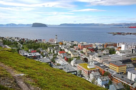 Town of Hammerfest with the downtown area, and cathedral with mountains & fjords in the background. Hammerfest is the northernmost town in the world with more than 10,000 inhabitants, county, Norway.