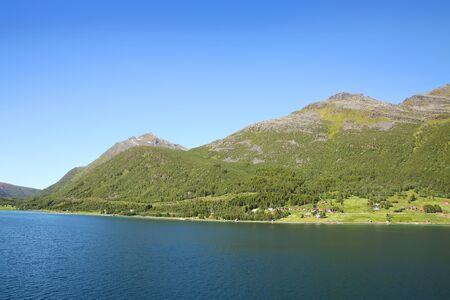 Beautiful scenic landscape of fjords, islands, village & inside passages; the Andfjorden & Vestfjorden, between Bodo & Hammerfest, Norway. Stock Photo