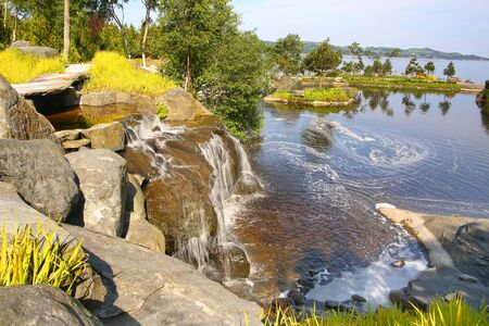 Beautiful landscape with a waterfall on a summer day, Stavanger,  Rogaland county, Norway.