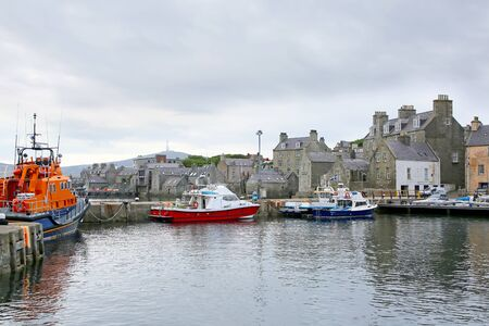 Harbour with fishing boats, lifeboat & buildings in the background, Lerwick, Shetland Islands, Scotland.