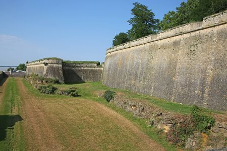 Historic city walls around the moat and fortifications to the citadel of Blaye, Gironde department in Nouvelle- Aquitaine in southwestern France.
