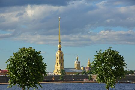 View of the city skyline with Peter & Paul Cathedral spires in the background on Hare Island along the Neva River, St Petersburg, Russia.
