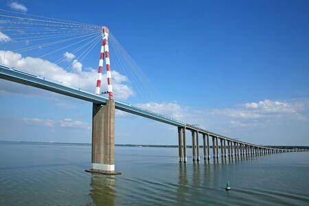 View of the Saint-Nazaire Bridge which is a cable-stayed bridge spanning the Loire River, linking Saint-Nazaire on the north bank and Saint-Brevin-les-Pins on the south bank, Loire-Atlantique, Pays de la Loire, France.