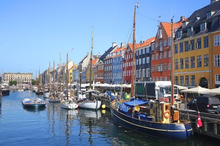 View of Nyhavn which is a Historic 17th-century waterfront with wooden ships, canal, colourful buildings and entertainment district in Copenhagen, Denmark. Stock Photo