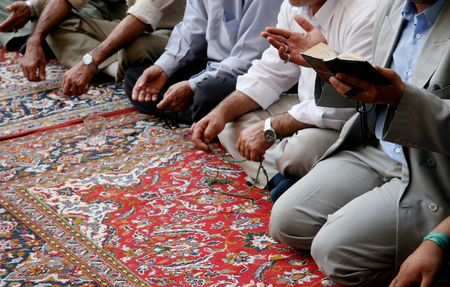 Muslim men singing a lament for their prophet Mohammed in a shiite mosque in Damascus, Syria. Stock Photo