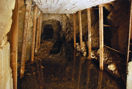 props: Tunnel with props in the mine Stock Photo