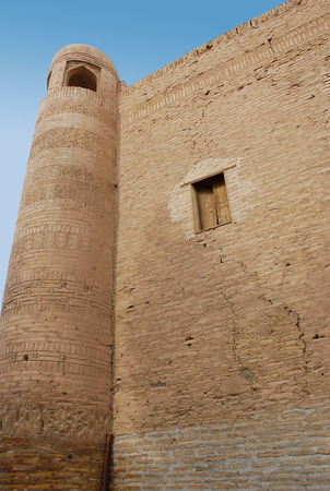 Ancient tower of the wall in the ancient city of Ichan-Kala